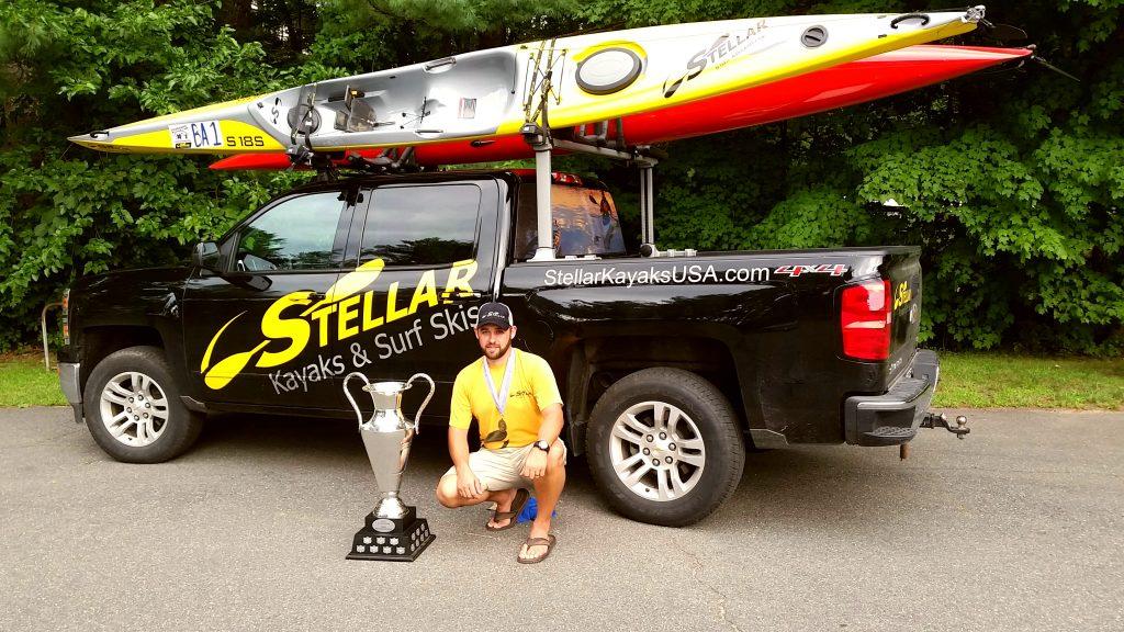 Man with Stellar Kayaks on truck