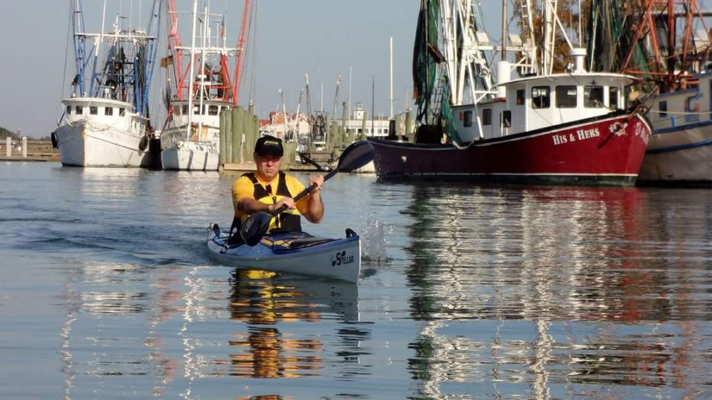 Man kayaks a Stellar Kayak in river